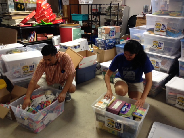 Volunteers sort and organize donated school supplies for C2C.
