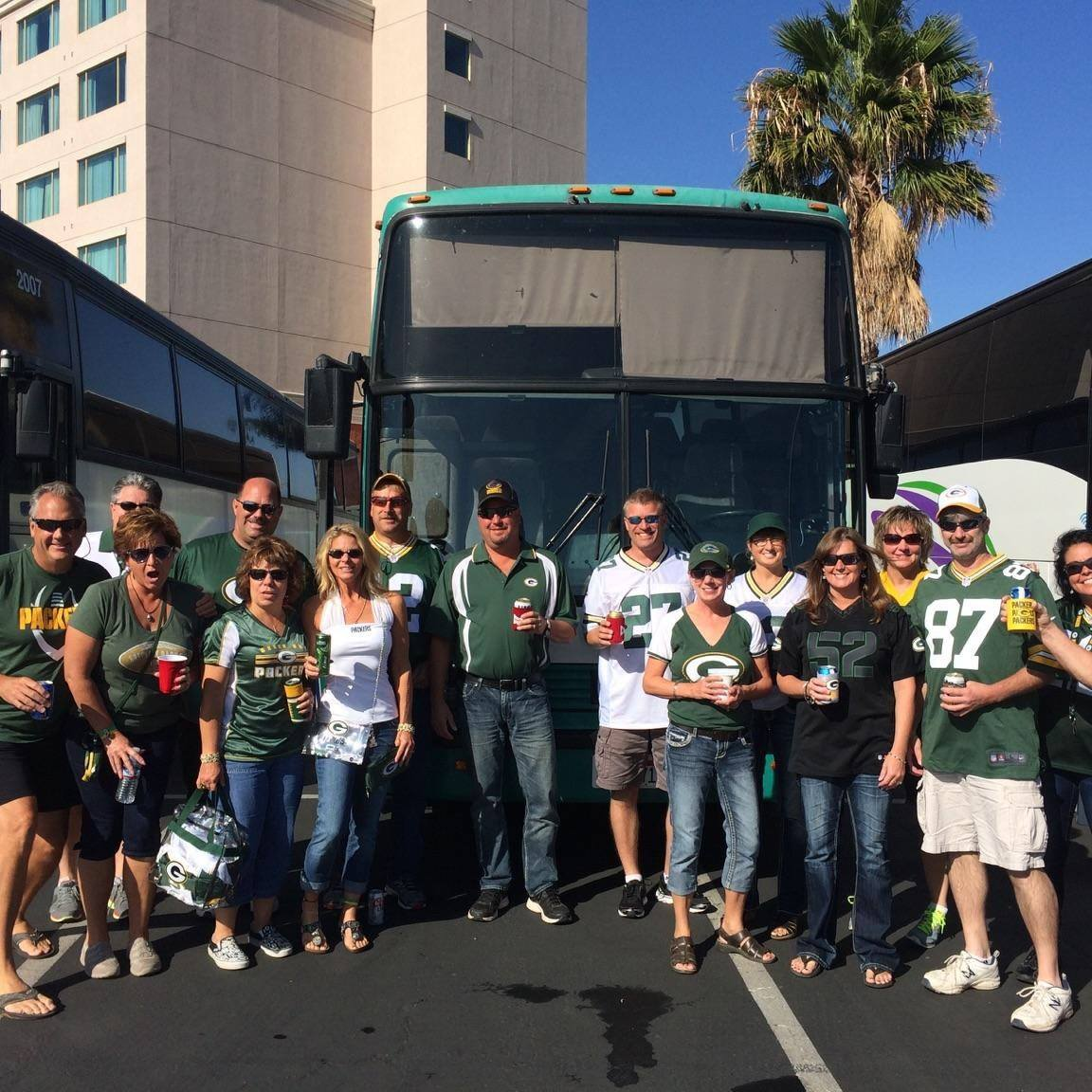 Green Bay Packers fans in front of their Rally bus in San Francisco, CA.