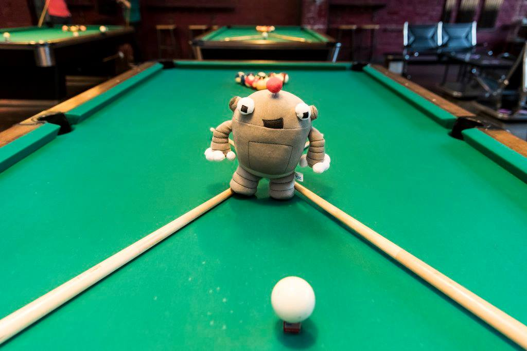 Roger, the Moz bot, shooting pool at MozCon